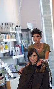Marci Rhodeman cuts Melinda Zilliox's hair Thursday at Avanti Salon, 1540 Wakarusa Drive, in a Victoria Beckham style.