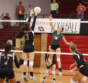 Free State's Grace Miller (18) sends a shot over the net to Lawrence High defender Karisa Sanders (3).
