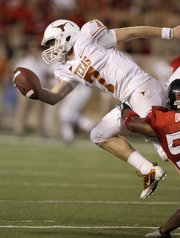Texas quarterback Garrett Gilbert (7) is sacked by Texas Tech defender Brian Duncan during their game Sept. 18 in Lubbock, Texas. Saturday, Gilbert will lead UT against rival Oklahoma in Dallas.
