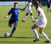 Madi Hillis (14) takes a shot during the Jayhawk's soccer match against Texas A&M University Friday afternoon at the Jayhawk Soccer Complex. The Jayhawks fell to the Aggies 1-0.