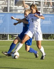 Rachel Shipley (7) takes the ball away from Erin Lewis (26) during a soccer match between Kansas University and Texas A&M University Friday afternoon at the Jayhawk Soccer Complex. The Aggies beat the Jayhawks 1-0.