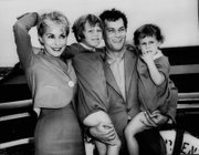 Tony Curtis and Janet Leigh pose with their children, Kelly 5, and Jamie, 2 1/2,  in this Sept. 19,1961, file photo prior to their departure on the SS Argentina. Curtis died Wednesday night at age 85.
