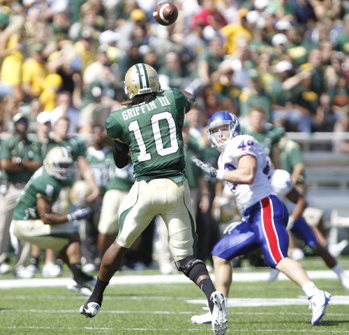 Kansas linebacker Drew Dudley turns to cover as Baylor quarterback Robert Griffin III throws during the second quarter Saturday, Oct. 2, 2010 at Floyd Casey Stadium in Waco, Texas.