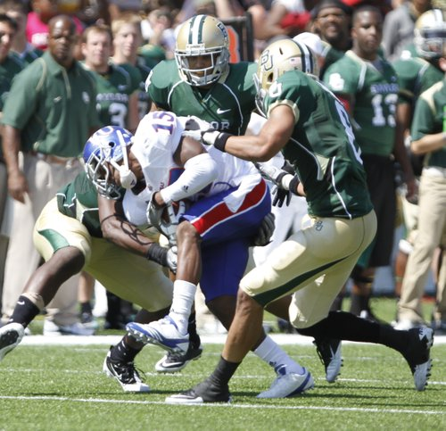 Baylor defenders smother Kansas receiver Daymond Patterson after a reception during the second quarter Saturday, Oct. 2, 2010 at Floyd Casey Stadium in Waco, Texas.