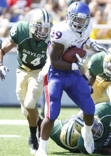 Kansas running back James Sims looks to break away from Baylor safety Byron Landor during the second quarter Saturday, Oct. 2, 2010 at Floyd Casey Stadium in Waco.