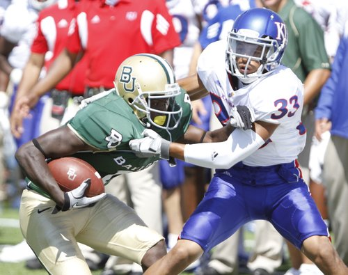 Kansas cornerback Tyler Patmon drags Baylor receiver Kendall Wright out of bounds during the second quarter Saturday, Oct. 2, 2010 at Floyd Casey Stadium in Waco.