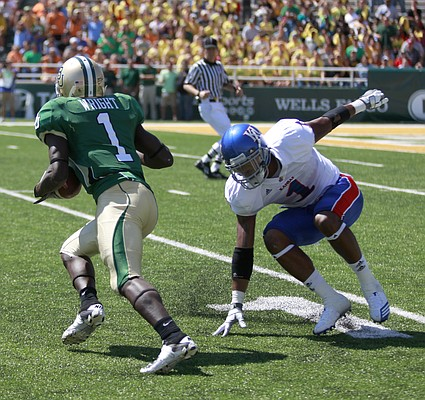 Kansas safety Lubbock Smith tries to keep up with Baylor receiver Kendall Wright during the third quarter Saturday, Oct. 2, 2010 at Floyd Casey Stadium in Waco, Texas.