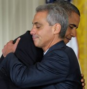 President Barack Obama hugs outgoing White House Chief of Staff Rahm Emanuel in the East Room of the White House in Washington on Friday during an announcement that Emanuel will be stepping down to run for mayor of Chicago. Obama announced that Pete Rouse will be interim chief of staff.