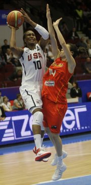 Tamika Catchings, left, of the United States shoots the ball past Spain's Anna Cruz Lebrato. The U.S. routed Spain, 106-70, in the semifinals of the Women's World Championships on Saturday in Karlovy Vary, Czech Republic.