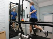 British middle distance runner Colin McCourt runs on a machine for research Tuesday in a lab at St. Mary's University College in London. Some experts say adding beetroot juice to your diet could give you a performance boost.