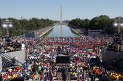 "Activists gather at the Lincoln Memorial in the nation's capital to participate in the ""One Nation Working Together"" rally to promote job creation, diversity and tolerance Saturday in Washington, D.C."