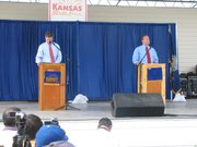Republican Sam Brownback and Democrat Tom Holland at the Kansas State Fair debate on Sept. 11 in Hutchinson.