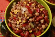 Grandma's slow cooker vegetarian chili uses three types of beans plus canned soup and corn to create a dish that's as easy as it is tasty.