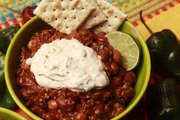 This four bean chili with chipotle cream seems like the perfect proof that it doesn't have to be cold for it to be chili season.
