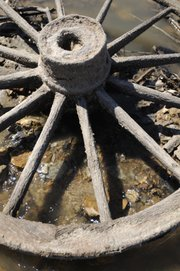 A wagon wheel sits in a low-water area of the Kansas River, Thursday, Oct. 7, 2010.