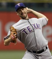 Texas left-hander Cliff Lee pitches during the second inning against Tampa Bay. Lee led the Rangers to a 5-1 victory over the Rays in Game 1 of an American League divisional playoff game on Wednesday in St. Petersburg, Fla.
