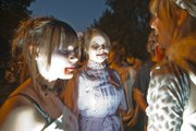 A trio of zombies gather during the fourth annual Lawrence Zombie Walk in 2010.