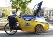 Colorado resident Tom Weis is riding across the country to raise awareness for renewable energy and stopped on KU campus to speak about it. His bike is tricked out with solar panels, an electric motor and three wheels.