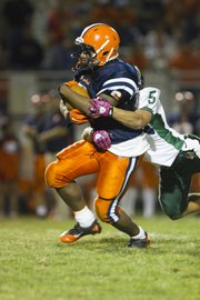 Olathe East running back Austin Fulson drags Free State linebacker Preston Schenck (5) during a big gain. O-East beat FSHS, 17-0, Friday in Olathe.