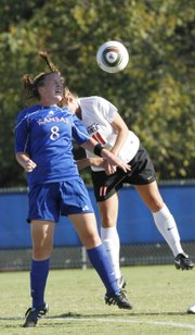 Erin Ellefson (8) heads the ball against Oklahoma State's Whitney Wernimont (11).