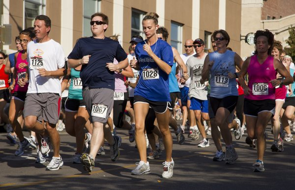Runners race down Seventh street during the 10K race that was part of the Bert Nash Dash & Bash last year in downtown Lawrence. Aside from featuring 5K and 10K races, live music, food and children's activities were part of the free public party.
