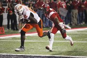 Oklahoma State wide receiver Justin Blackmon (81) pulls in a touchdown pass in front of Orkeys Auriene. Oklahoma State defeated Louisiana Lafayette, 54-28, on Friday in Lafayette, La.