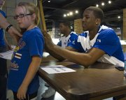 KU's Thomas Robinson autographs the shirt of Kate Dieker, 9, of Westphalia.