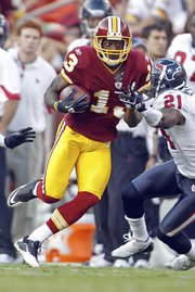 Washington Redskins wide receiver Anthony Armstrong carries the ball against the Houston Texans on Sept. 19 in Landover, Md. Washington is 2-2 entering today's game against Green Bay.