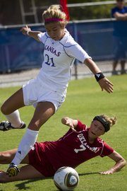 Oklahoma forward Jordan White (7) tackles Kansas University forward Emily Cressy. KU suffered a 3-1 loss to OU Sunday at the Jayhawk Soccer Complex.