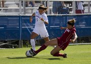 Oklahoma forward Jordan White (7) knocks the ball away from Kansas University forward Kortney Clifton (5) Sunday afternoon at the Jayhawk Soccer Complex. Oklahoma won the game 1-0.
