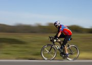 A cyclist speeds past as part of the Octoginta ride held Sunday morning in and around Douglas County.