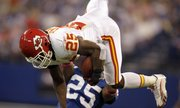 Kansas City Chiefs running back Jamaal Charles, top, leaps over Indianapolis Colts cornerback Jerraud Powers in the first quarter. Charles — and the Chiefs — eventually came back to earth in a 19-9 loss Sunday in Indianapolis.