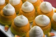 Candy corn cupcakes are seen in this photo. Inspired by Halloween's most iconic candies these cupcakes are a totally different take on the familiar yellow, orange and white treat.
