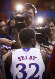 Kansas freshman guard Josh Selby draws the attention of television cameras during media day on Tuesday  at Allen Fieldhouse.