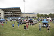 Tailgaters gather around outside Memorial Stadium on a rainy Saturday last month before the New Mexico State game.