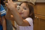 Sophia McLaughlin, 3, downs her solution drink.