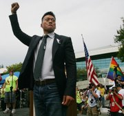 "Former Lt. Dan Choi, an Iraq combat veteran who was discharged under the U.S. military's ""don't ask, don't tell"" policy, appears at an equality rally in Fresno, Calif., in this May 30, 2009, file photo. A federal judge issued a worldwide injunction Tuesday stopping enforcement of the ""don't ask, don't tell"" policy, ending the military's 17-year-old ban on openly gay troops."