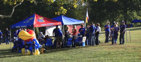 Crowds gathered on the hill near Memorial Stadium to tailgate for Thursday evening's KU football game against K-State.