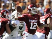 Oklahoma quarterback Landry Jones (12) throws from the pocket against Texas in this file photo from Oct. 2 at the Cotton Bowl in Dallas. The Sooners are picking apart defenses again with their hurry-up offense.