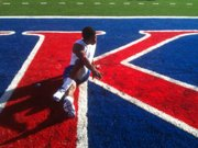 Kansas running back Ryan Burton stretches before taking on Kansas State Thursday, October 14, 2010 at Memorial Stadium.