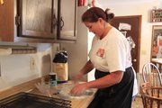 Caroline Wroczynski prepares pierogie dough in her home. The Lawrence business owner has a passion for the Polish food, and has been selling her creations via her company Those Polish Thingies.