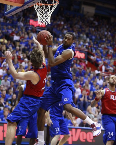 Kansas walk-on Justin Wesley comes down with a rebound over Blue Team defender Conner Teahan during the Late Night in the Phog scrimmage, Friday, Oct. 15, 2010.
