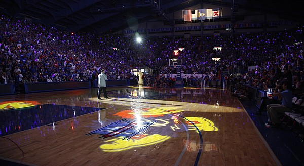 Large Jayhawks are cast onto the court as Kansas head coach Bill Self addresses the crowd during Late Night in the Phog, Friday, Oct. 15, 2010.