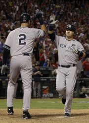 New York's Derek Jeter (2) greets Nick Swisher after both scored on a bases-loaded single by Alex Rodriguez. The Yankees rallied to win Game 1 of the ALCS, 6-5, on Friday in Arlington, Texas.