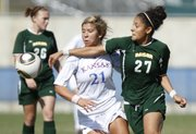 Kansas forward Emily Cressy and Baylor defender Lucy Quintana get physical as they compete for the ball during the first half Sunday, Oct. 17, 2010.