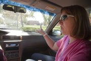 Lori Stussie gives her son, Andrew, some guidance behind the wheel.