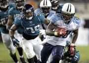 Tennessee Titans running back Chris Johnson (28) runs for a 35-yard touchdown past Jacksonville safety Courtney Greene in the second half of the Titans' 30-3 victory Monday in Jacksonville, Fla.