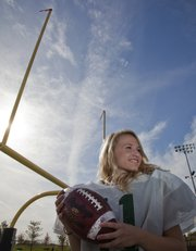 A longtime soccer player, Amanda Moyer joined the Free State football junior varsity team as a place kicker before earning a promotion to the varsity.