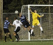 Free State goal keeper Elliott Johnson (0) blocks a Shawnee Mission East shot. The Firebirds won, 2-1, on Tuesday at Free State High.