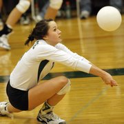 Free States Shelby Holmes digs a ball against Blue Valley West on Tuesday at Free State High.